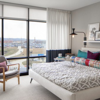 Light filled bedrooms with floor-to-ceiling glass windows offering gorgeous waterfront views.