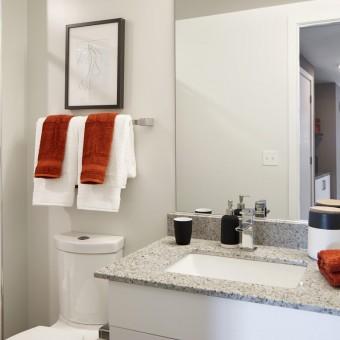 Relaxing baths with luxurious rectangular sink vanities.