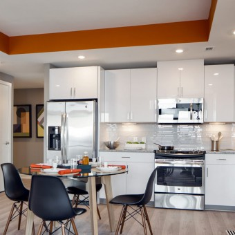 Stunning kitchens with designer white cabinetry with pantries and under-counter lighting.