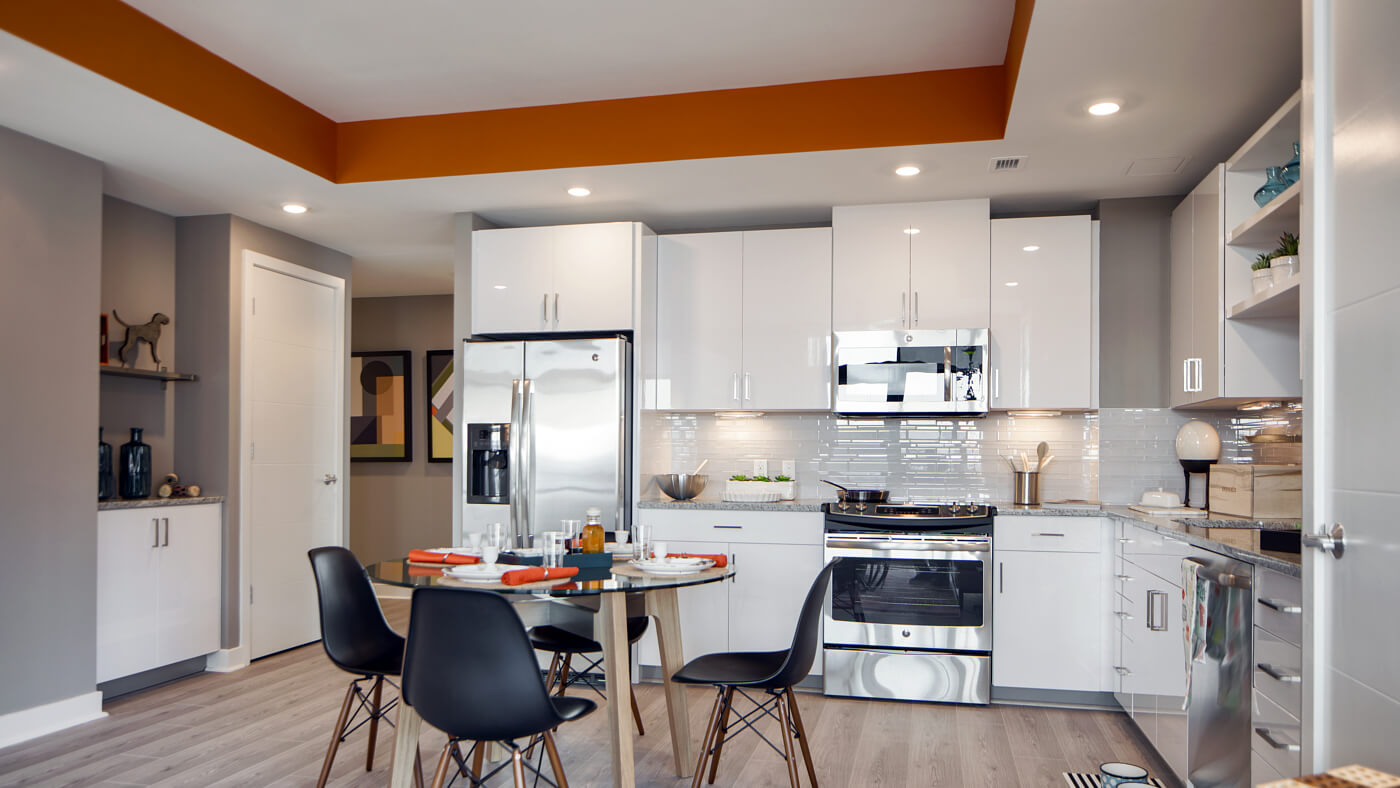 Stunning kitchens with designer white cabinetry with pantries and under-counter lighting